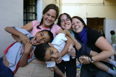 Volunteers enjoying play time with children at a daycare on a Care project in Mexico.
