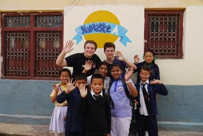 Projects Abroad Teaching volunteers with a group of children at a placement in Kathmandu, Nepal.