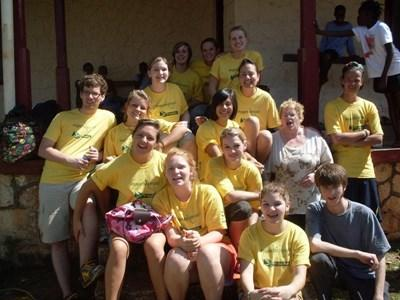 Alumni receive Projects Abroad t-shirts after completing their volunteer projects in Jamaica.