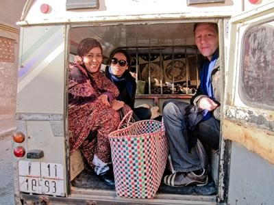 Locals in Morocco take volunteers for a ride around town in their van on the Nomad project