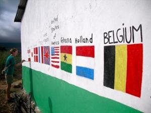 Volunteers leave their mark by painting their flags on a school at the end of a building project in Ghana