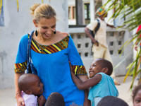 A volunteer plays with young children at a Care placement in Ghana.
