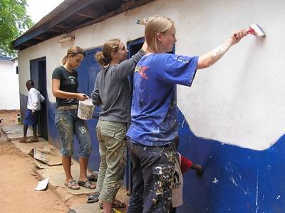 High School Volunteers painting Ghana, West Africa