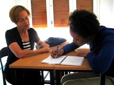 Professional teacher volunteering with student in South Africa