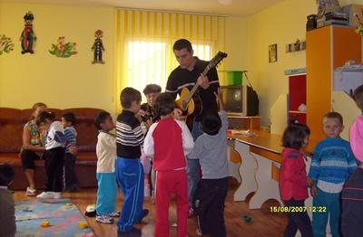 Art therapy volunteer dancing with children at placement in Romania