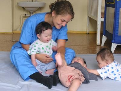 Volunteer with babies at a Care placement in Mongolia with Projects Abroad