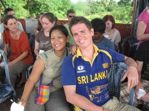 Volunteer with staff in Sri Lanka