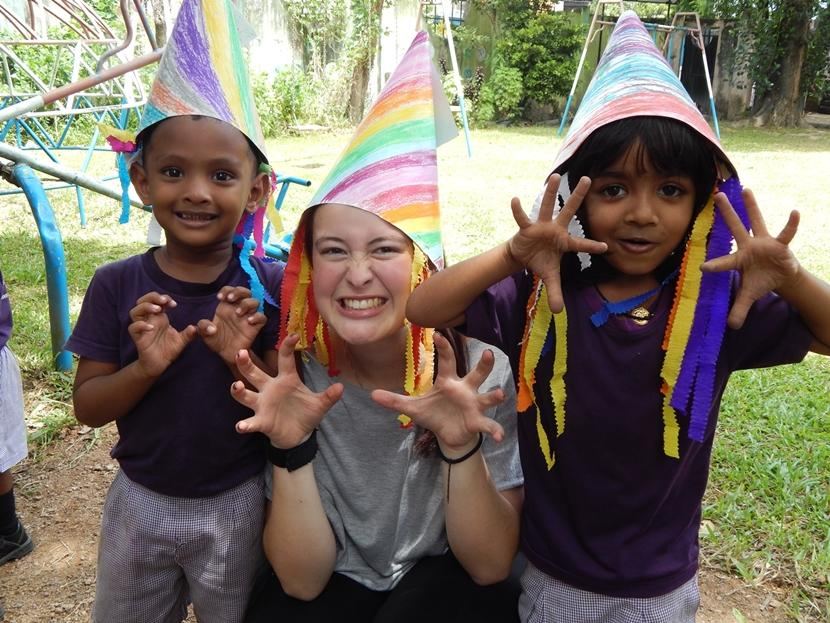 Projects Abroad Care volunteer, Madeleine Westley from New Zealand, dresses up with young children at the Care project in Sri Lanka