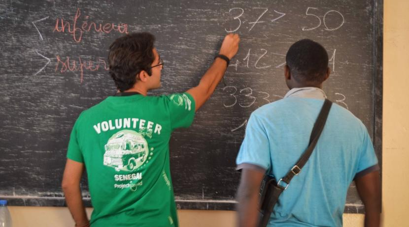 A Projects Abroad volunteer teaches a former talibe at a micro-finance centre