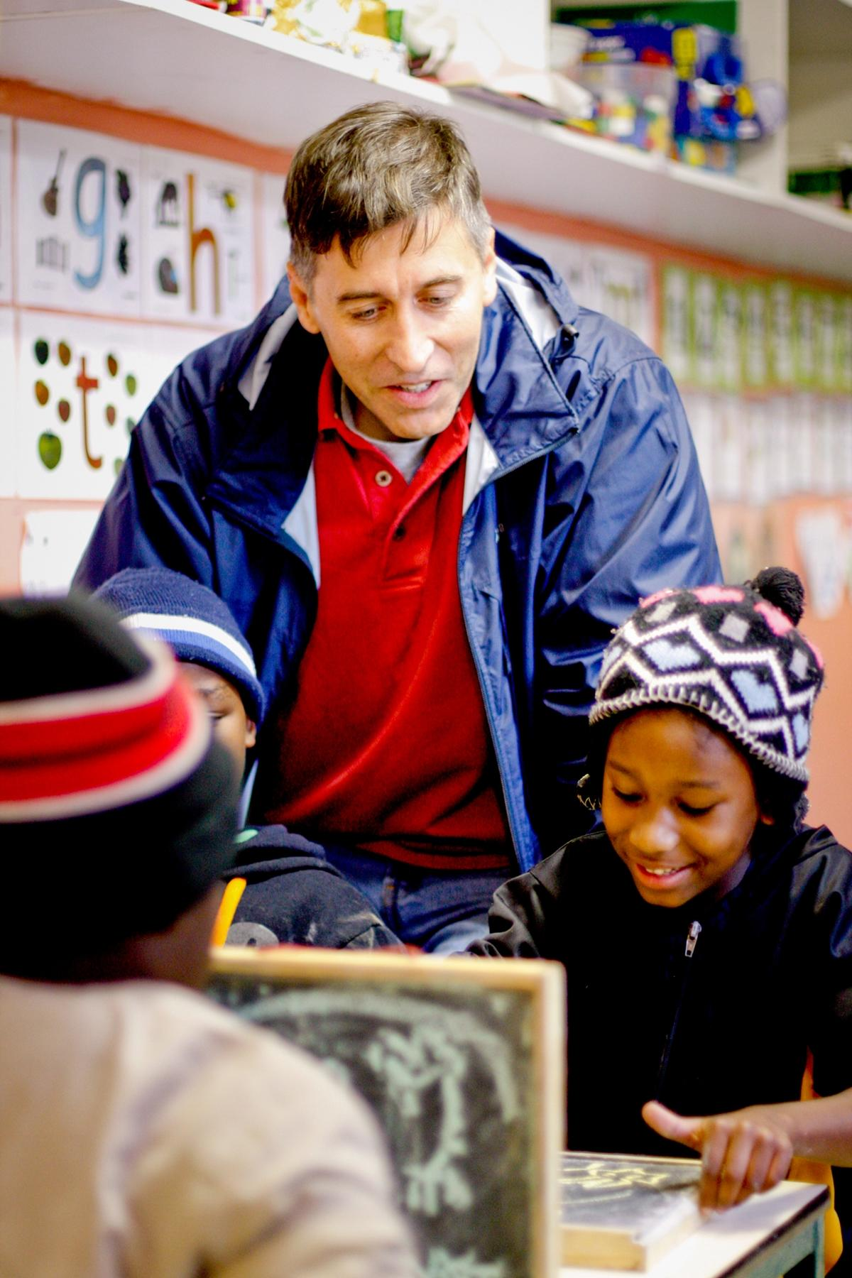 volunteer abroad for career breakers projects abroad zoom career break volunteer assisting student classwork on a teaching project in south africa