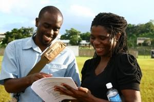 Staff reading with volunteer on a project with Projects Abroad