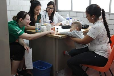 University students on a summer volunteer program work at a Public Health Project.