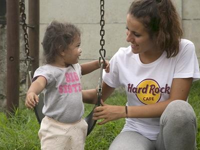 A Projects Abroad Care volunteer plays with a child at a day care centre in Heredia, Costa Rica.