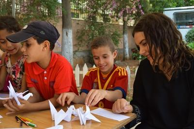 Projects Abroad volunteer helps children with an activity on her volunteer overseas program in Morocco, North Africa.