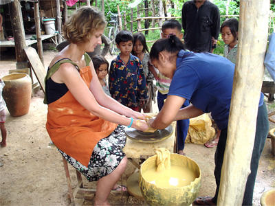 On a volunteer trip to Cambodia, a volunteer interacts with local people at her project