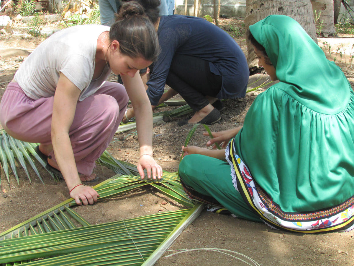 volunteering opportunities abroad projects abroad zoom volunteer arranging a palm tree structure in a local community projects abroad