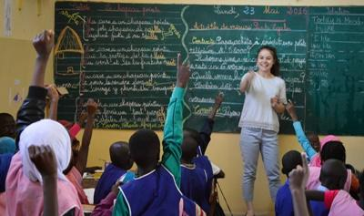 A volunteering opportunity abroad brought this volunteer to a classroom in Senegal to teach disadvantaged children