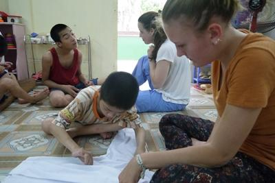 Physical Therapy interns work with children with special needs in Vietnam, Southeast Asia.