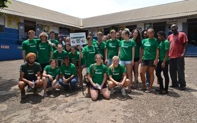 Projects Abroad volunteer group paint the inside of the grade one classrooms at the McIntosh Primary School in Mandeville for a community day event.
