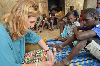A Senegalese child receives basic medical treatment from a Projects Abroad volunteer on a program similar to a mission trip.