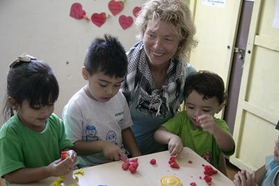 Three Costa Rican children enjoy playtime with a Projects Abroad volunteer.