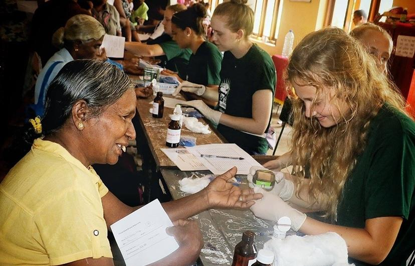 Medical volunteer assists at an outreach in Sri Lanka