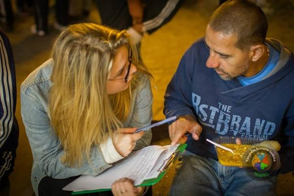 Projects Abroad Human Rights intern interviews a homeless man in order to try and help him get a pension and ID card in Cordoba, Argentina.