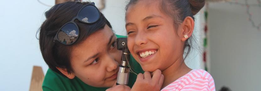 A Projects Abroad volunteer conducts a medical checkup at a community outreach in Guadalajara, Mexico.