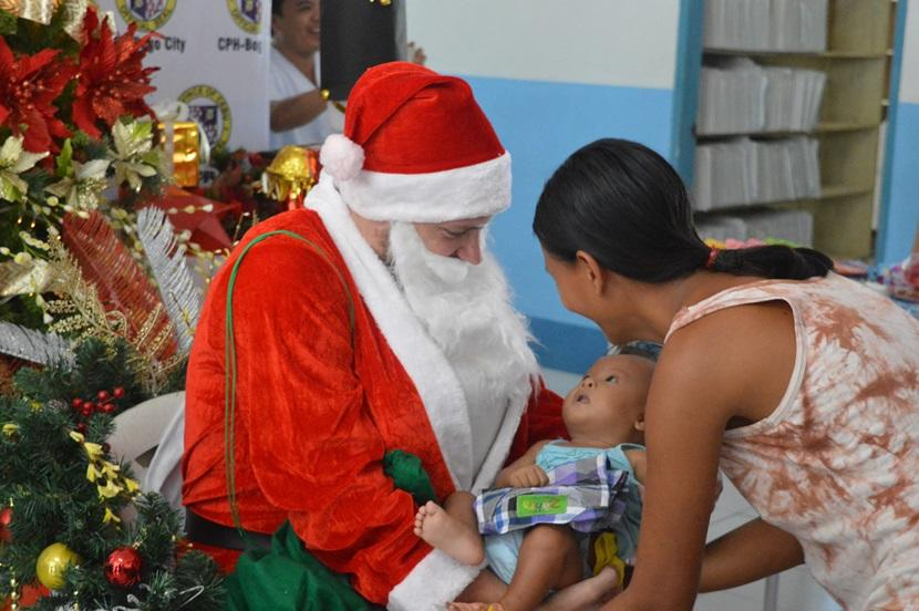 A Projects Abroad volunteer dressed up as Santa Claus at a Christmas party for children at a Care placement.