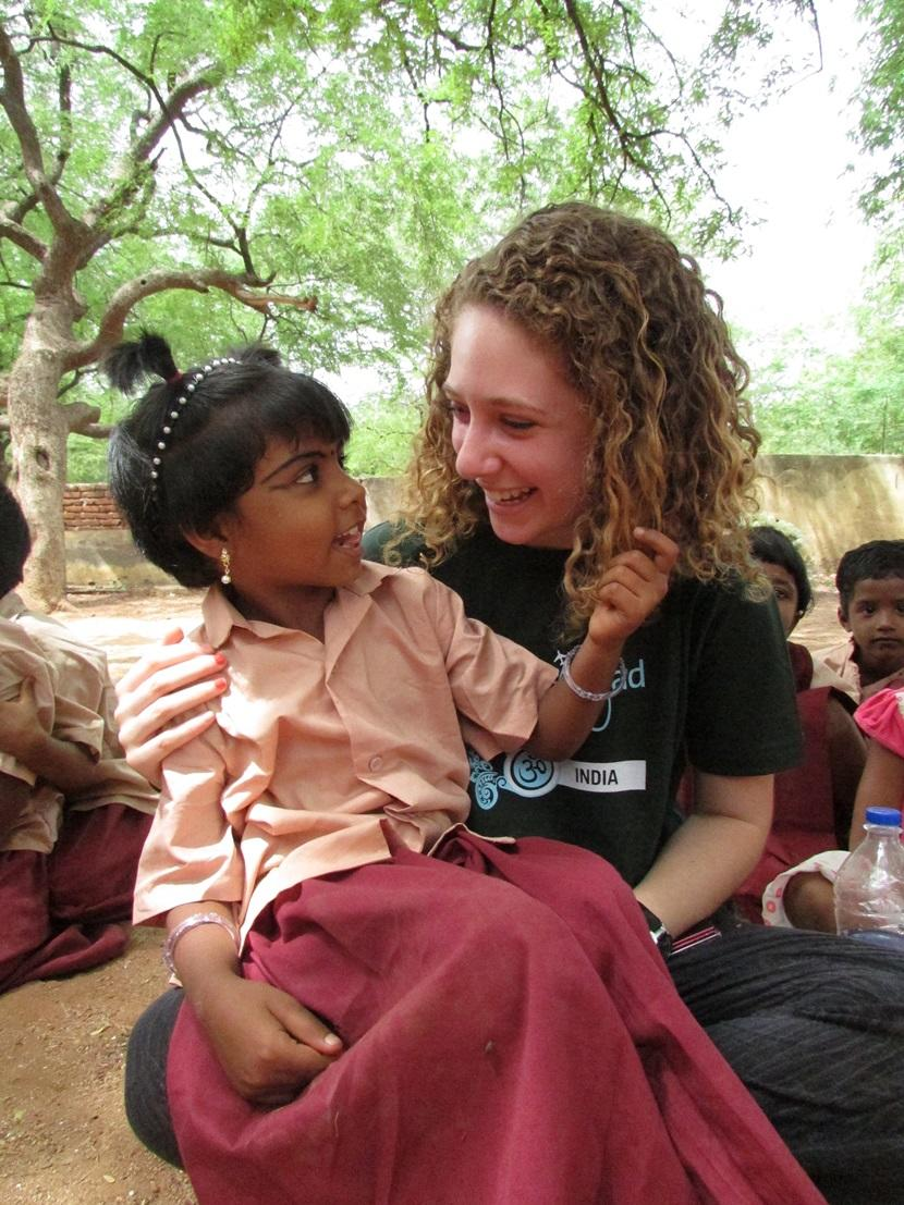 A Projects Abroad volunteer spends time with a child at a Care placement in India