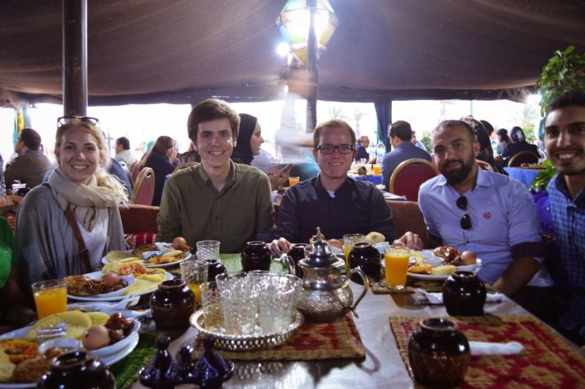 Projects Abroad volunteers and staff members enjoy an evening meal together during Ramadan