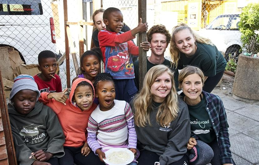 Projects Abroad volunteers spend time with children at a care centre in South Africa