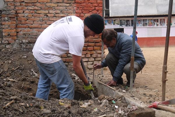 Projects Abroad volunteer digging a plot of land to build at the Disaster Relief project in Nepal