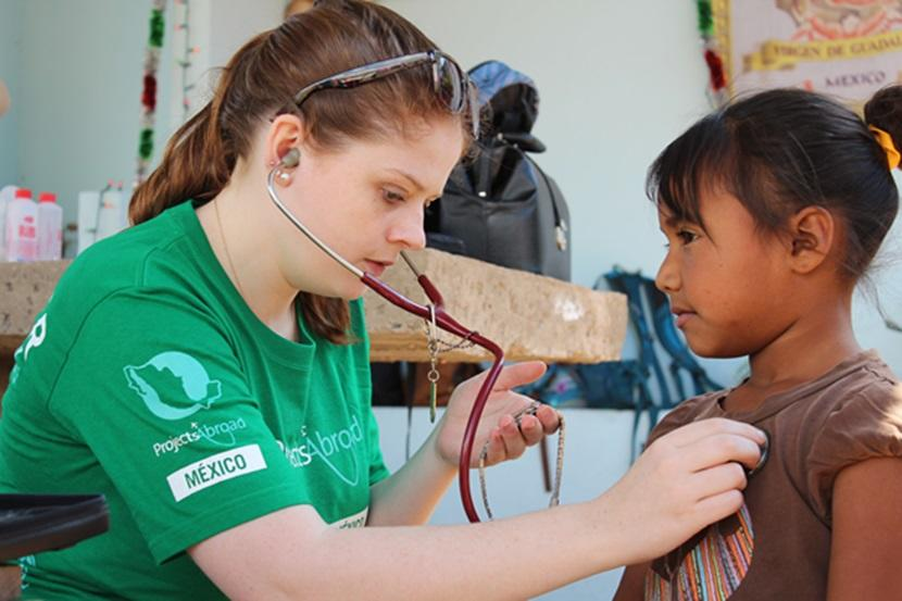 Medicine and Public Health volunteer works on a community outreach in Mexico