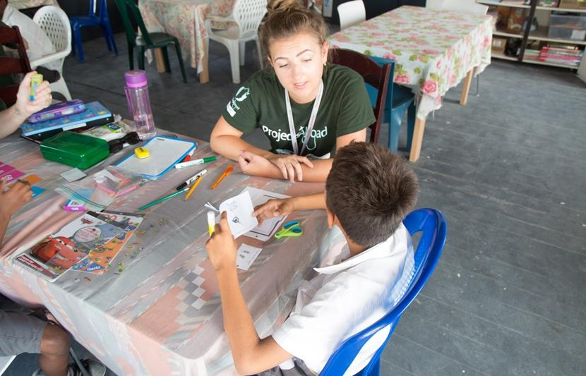 A one-on-one session between a teaching volunteer and a student on Projects Abroad's literacy program in Belize.