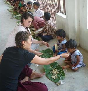 Projects Abroad volunteers help feed orphans at the Love & Care orphanage an Indian lunch