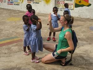 A Projects Abroad Volunteer plays with children on the Care & Community Project in Ghana.