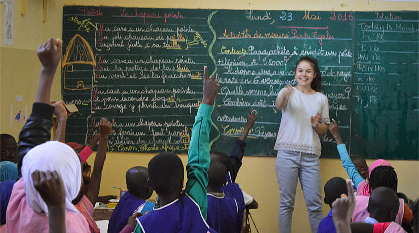 A Projects Abroad volunteer teacher leads an English class at a school in Senegal