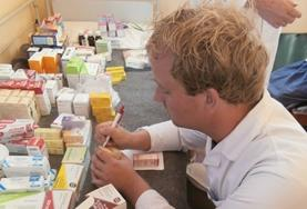 A pharmacy intern takes notes at his volunteer placement in Sri Lanka.