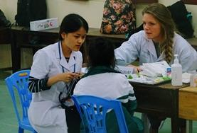 Volunteers on the International School Pharmacy Project sort medication at their placement.