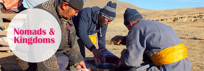 Projects Abroad volunteer helps local nomads cook in Mongolia, Asia.
