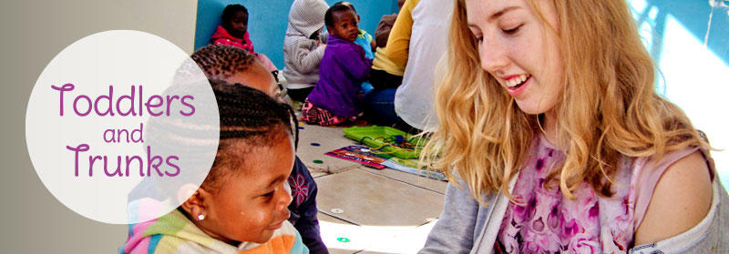 Projects Abroad volunteer does an educational activity with a child at a Care Project in Cape Town, South Africa.
