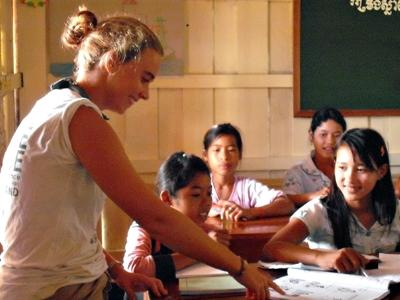 Projects Abroad volunteer teaches local children in a classroom in Cambodia.
