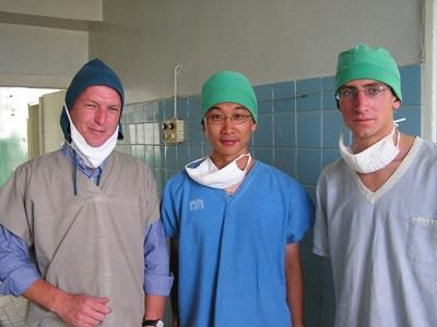 Male volunteers dressed in hospital scrubs on their Medicine project in Asia