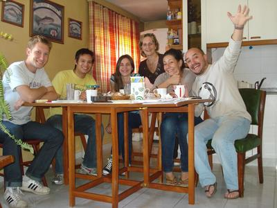 Volunteers sit down for a meal with their local host family in Cordoba, Argentina