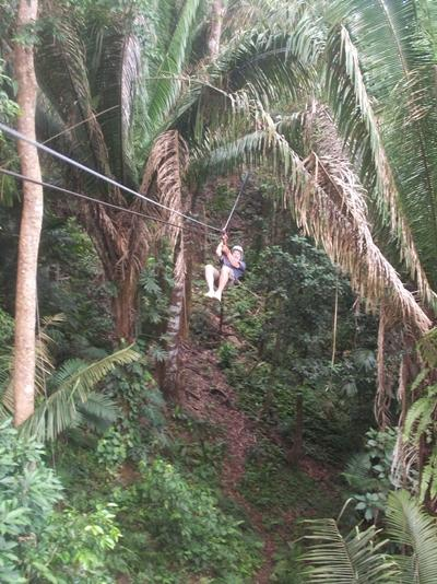 A Projects Abroad volunteer enjoys leisure time in Belize and goes ziplining in a forest