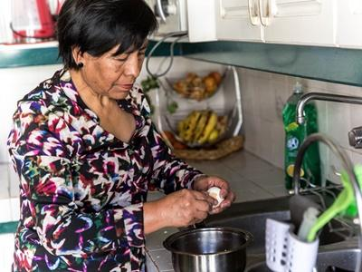 A local woman cooking dinner