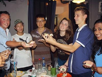 Volunteers enjoying dinner together in China