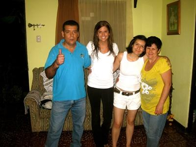 Projects Abroad Costa Rica volunteer poses for a picture with her host family