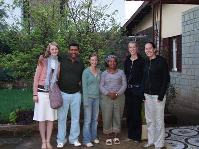 Volunteers and Ethiopian host family outside house
